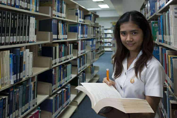 A university student in the library. (CC World Bank Photo Collection on FlICKR)